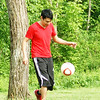 Angel Hernandez kicking a soccer ball around at Mounds State Park.<br /> <br /> Photographer's Name: Morgan Elbert<br /> Photographer's City and State: Alexandria, Ind.