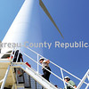 Lieutenant Governor Sheila Simon (center) climbs the steps to begin a journey to the top of a wind mill near Compton. Simon stopped by the Goldwind windfarm to tour and climb the 100 meter to the top of the 2.5 megawatt windmill.