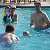 Hallie swimming from Daddy to Papa.