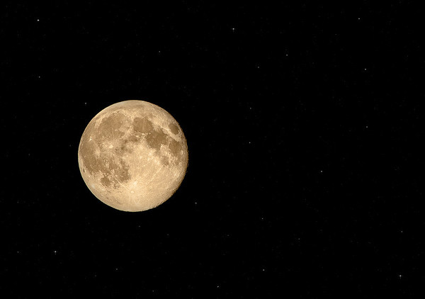 The super moon on Sunday evening, as seen from my back door.<br /> <br /> Photographer's Name: Terry Lynn Ayers<br /> Photographer's City and State: Anderson, Ind.