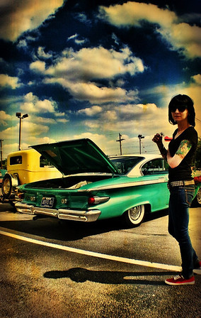 Megan Dyer checks out a 1961 Plymouth Fury in Albany, Ind.<br /> <br /> Photographer's Name: Jesse Lawson<br /> Photographer's City and State: Anderson, Ind.