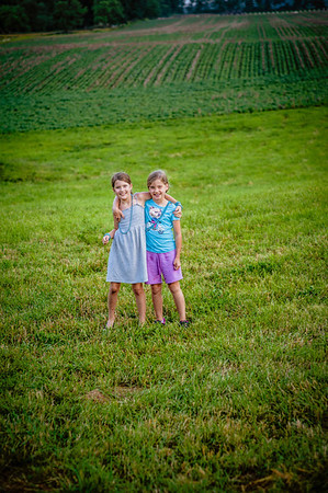 Elise and Libby playing in the grass.<br /> <br /> Photographer's Name: Terry Lynn Ayers<br /> Photographer's City and State: Anderson, Ind.