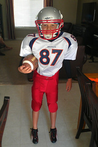 Hayden modeling his football uniform