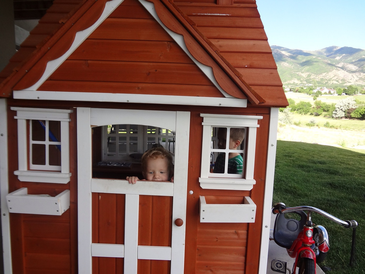 Caleb loved opening and closing the door to the playhouse