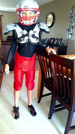 Hayden proudly showing off his football uniform