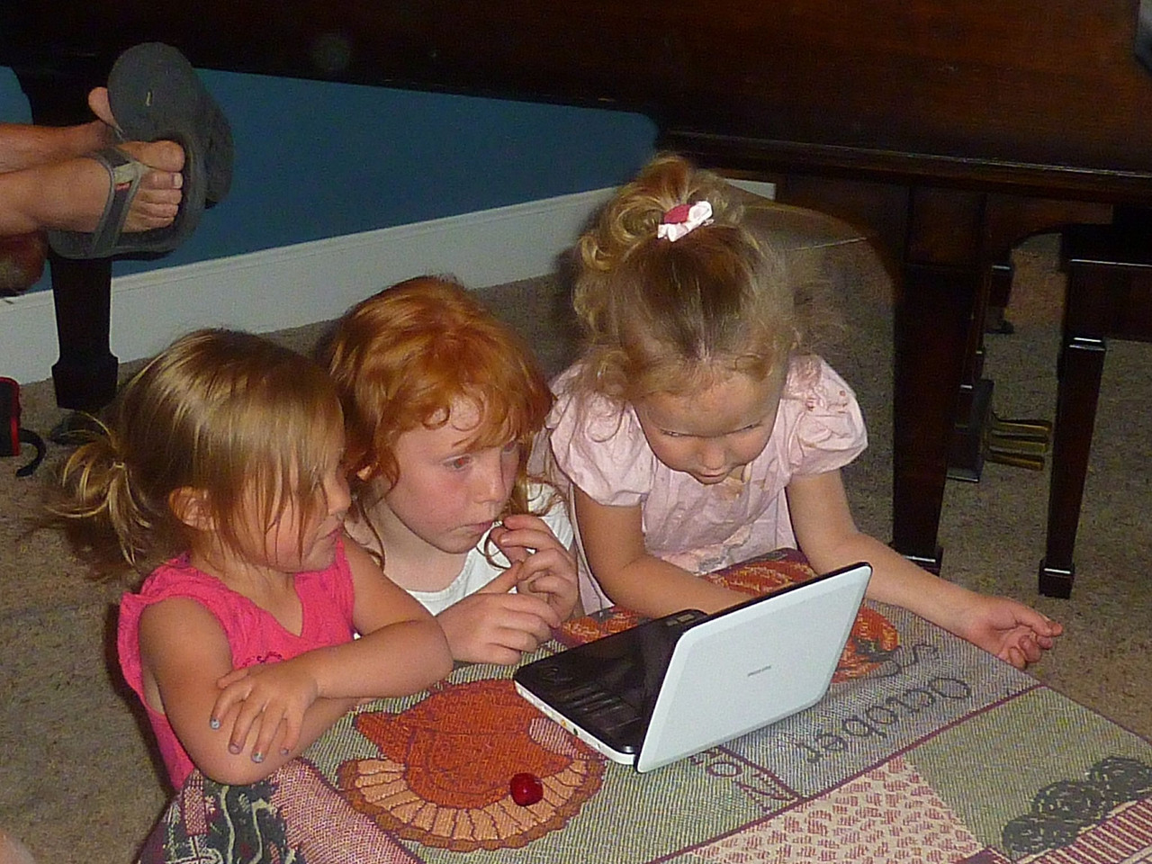 3 granddaughters mesmerized by a DVD