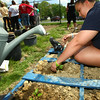 5-8-13<br /> Kokomo Area Career Center culinary arts students planting an herb and vegetable garden at KHS.<br /> Aleigha Smalls plants peppers.<br /> KT photo | Tim Bath