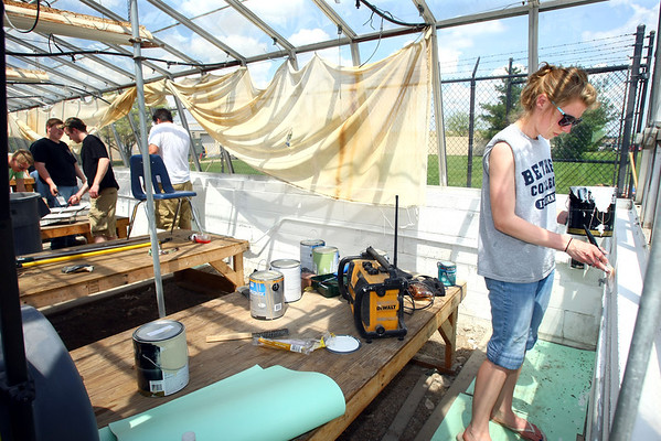 5-8-13<br /> Kokomo Area Career Center culinary arts students planting an herb and vegetable garden at KHS.<br /> Macayla Sitzes along with the other building trades students paint and fix up the greenhouse on the east side of the school.<br /> KT photo | Tim Bath