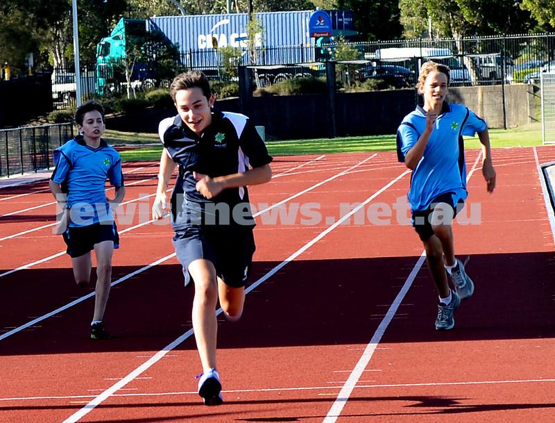 jnr carnival 2013. Noa Shenker (VIC)  winning the 200m. Sydney. photo: Henry benjamin.
