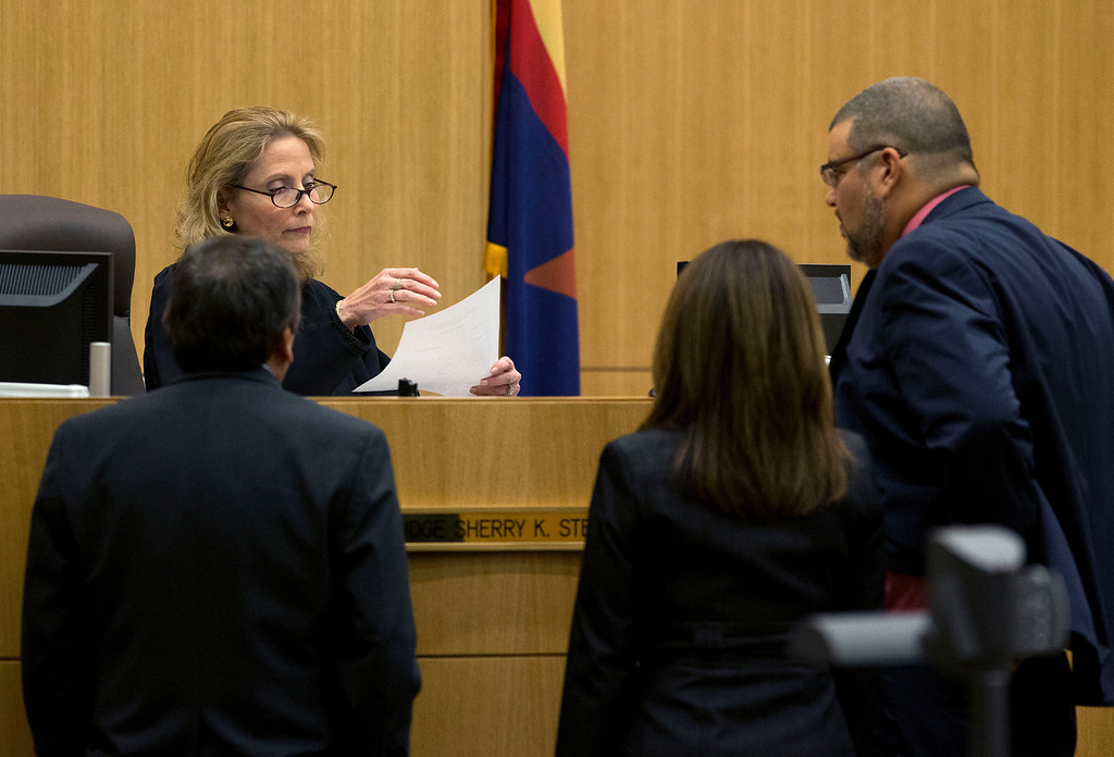 . Judge Sherry Stephens looks at a question from the jury with prosecutor Juan Martinez, left, and defense attorneys Jennifer Wilmott and Kirk Nurmi, right, on Wednesday, May 22, 2013 during the penalty phase of the Jodi Arias murder trial at Maricopa County Superior Court in Phoenix .    Arias was convicted of first-degree murder in the stabbing and shooting to death of Travis Alexander.  (AP Photo/The Arizona Republic, Rob Schumacher, Pool)