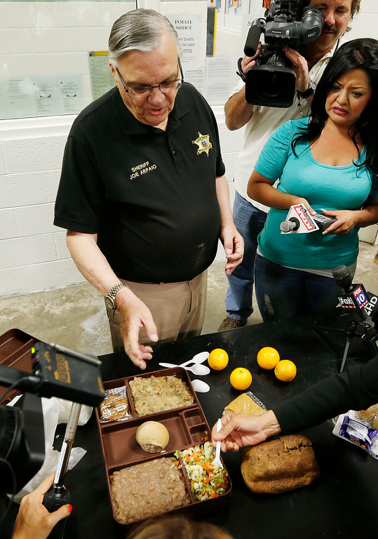 . Sheriff Joe Arpaio explains a typical meal served to convicted killer Jodi Arias and all the other inmates at the Maricopa County Sheriffs Office Estrella Jail, during a news conference, on Thursday, May 16, 2013, in Phoenix. (AP Photo/Ross D. Franklin)