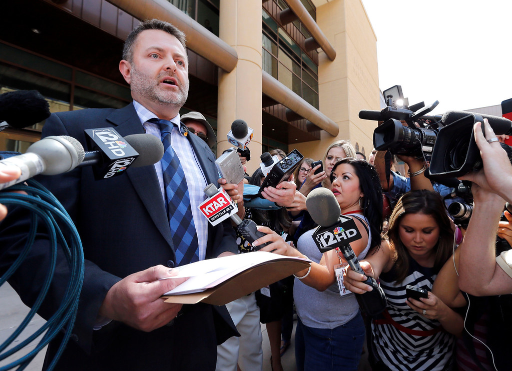 . Attorney Jay Beckstead, who represents the siblings of Travis Alexander, speaks on the steps of Superior Court in Phoenix, Wednesday, May 8, 2013 after a guilty verdict in the trial of Jodi Arias, a waitress and aspiring photographer charged with killing her boyfriend, Travis Alexander, in Arizona in 2008. The four month trial included graphic details of their sexual escapades and photos of Alexander just after his death. (AP Photo/Matt York)