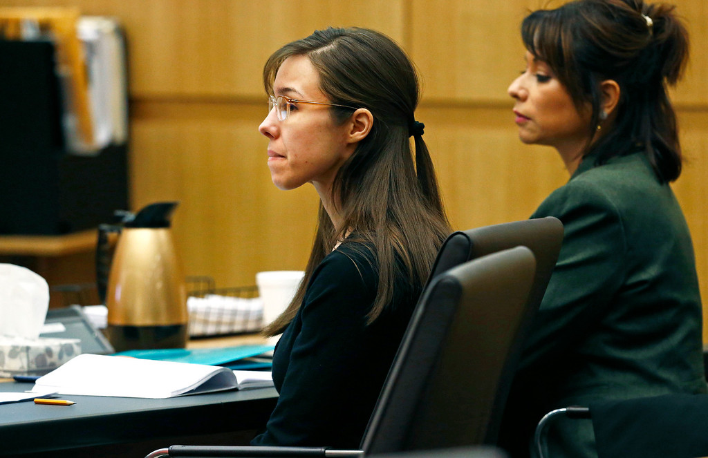 . Defendant Jodi Arias, center, listens to defense attorney Kirk Nurmi make his closing arguments during her trial on Friday, May 3, 2013 at Maricopa County Superior Court in Phoenix.  Arias is charged with first-degree murder in the stabbing and shooting death of Travis Alexander, 30, in his suburban Phoenix home in June 2008. (AP Photo/The Arizona Republic, Rob Schumacher, Pool)