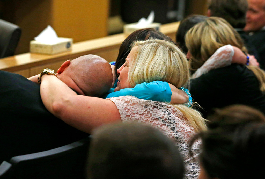 . Family and friends of Travis Alexander react after Jodi Arias was found guilty of first-degree murder in the gruesome killing of Alexander, her one-time boyfriend, in their suburban Phoenix home, Wednesday, May 8, 2013, in Phoenix.  (AP Photo/The Arizona Republic, Rob Schumacher, Pool)