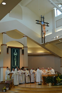 SCJs gather at the altar for Eucharist