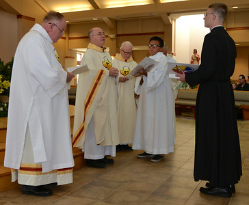 Fr. Steve accepts Justin's vows