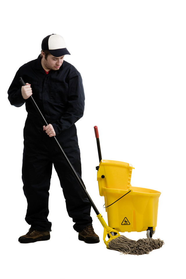 Young male posing as a janitor