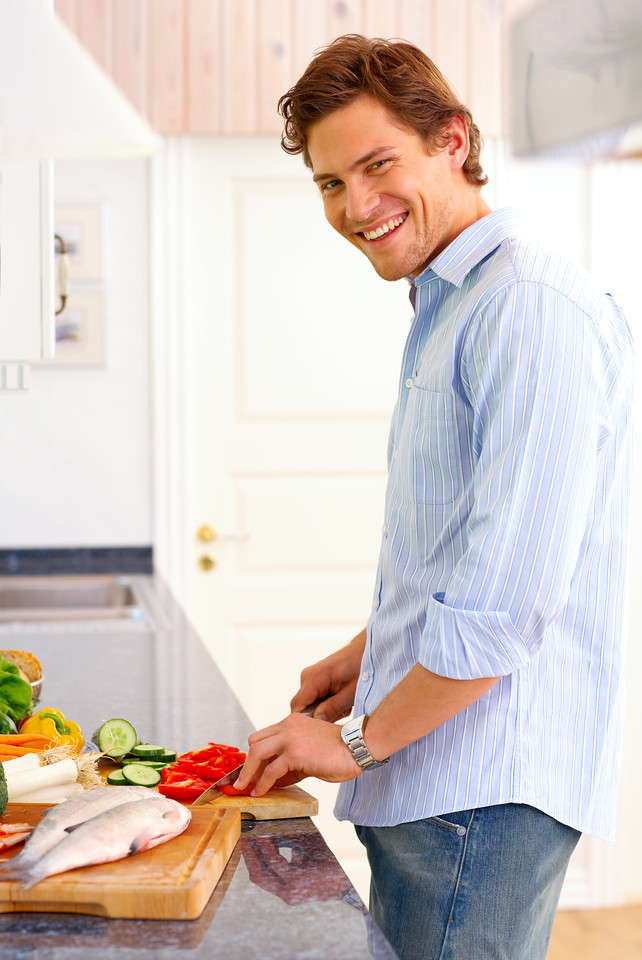 Portrait of a young man in his kitchen preparing a weekend breakfast dinner