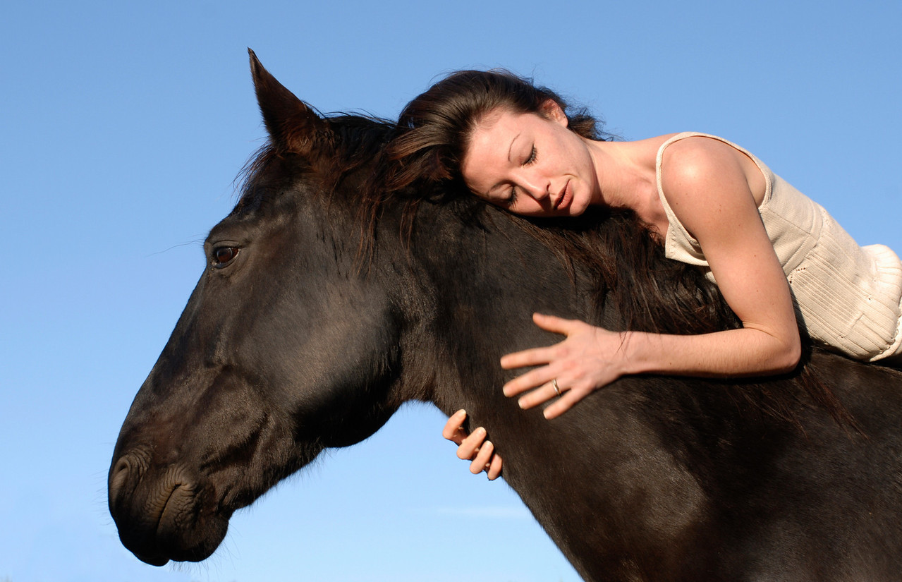 young woman and her best friend black stallion