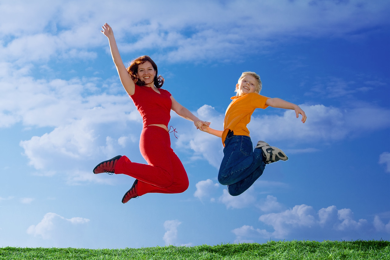 Flying  Family. Mother and Son Jumping