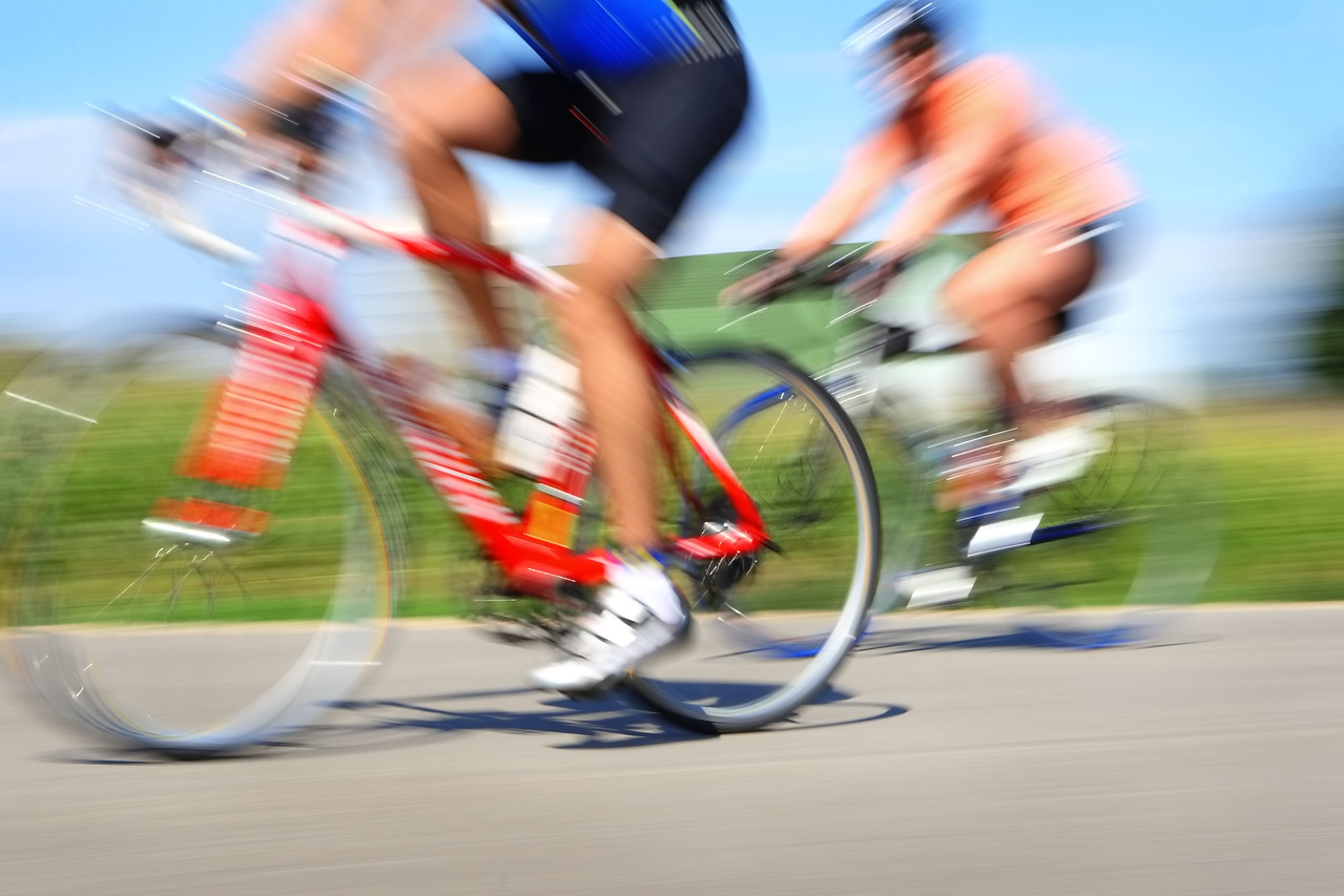 Two bicyclists in a race through the countryside