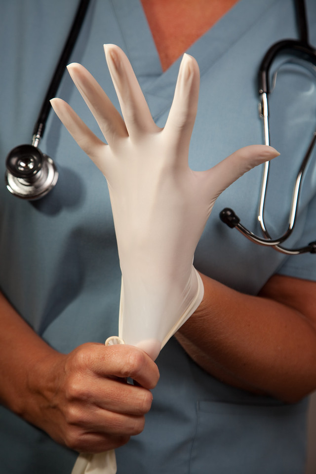 Abstract Image of Doctor Putting on Latex Surgical Gloves.