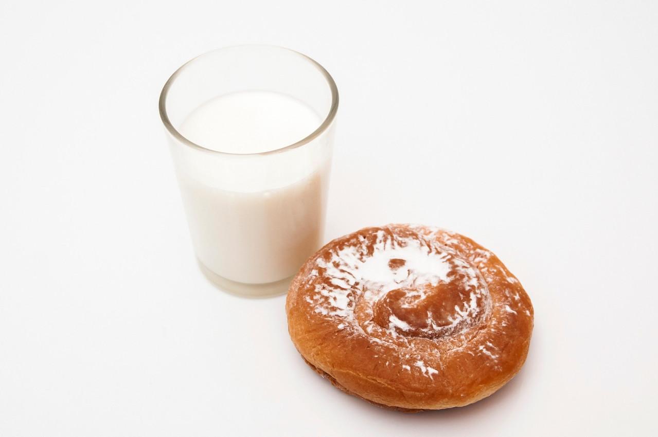 glass of milk with sugar ensaimada