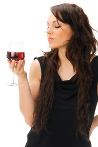 cute and young brunette in a black dress with a glass of  italian red wine