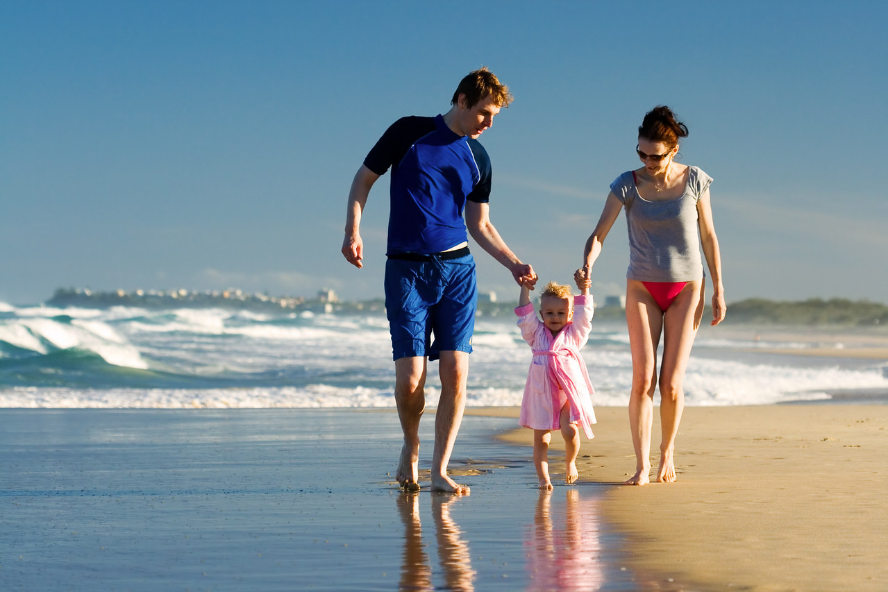 Young family walking on the beach