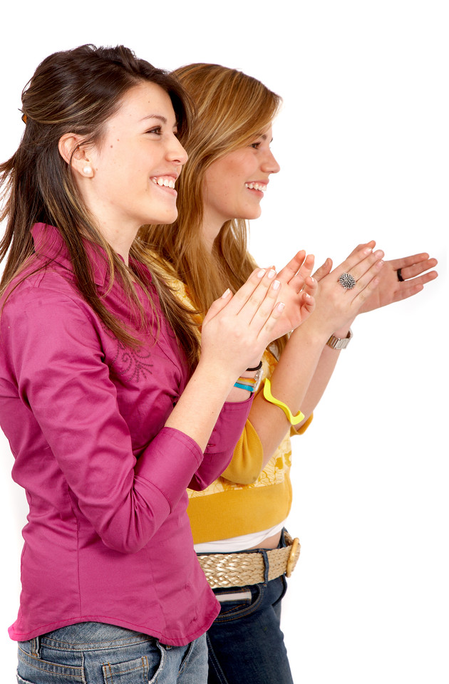 casual girls clapping smiling isolated over a white background