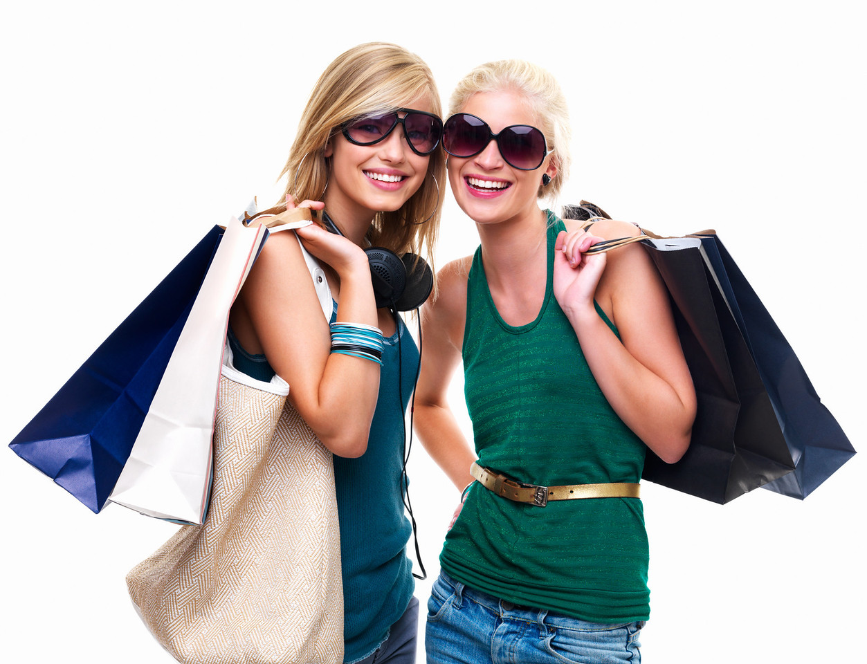Portrait of happy young girls standing together with shopping bags