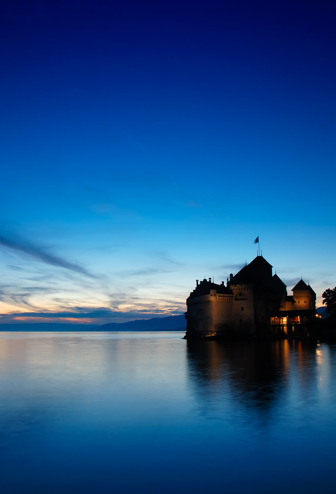 The Chateau de Chillon, on Lac Leman (Lake Geneva) at the 'blue hour' shortly after sunset. Space for text in the sky.