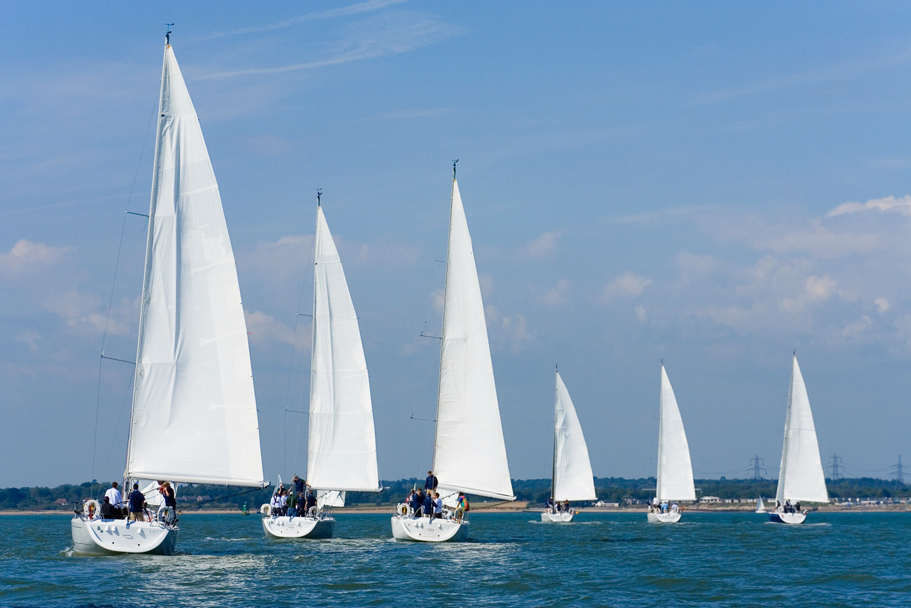 Six fully crewed yachts out sailing all with white sails