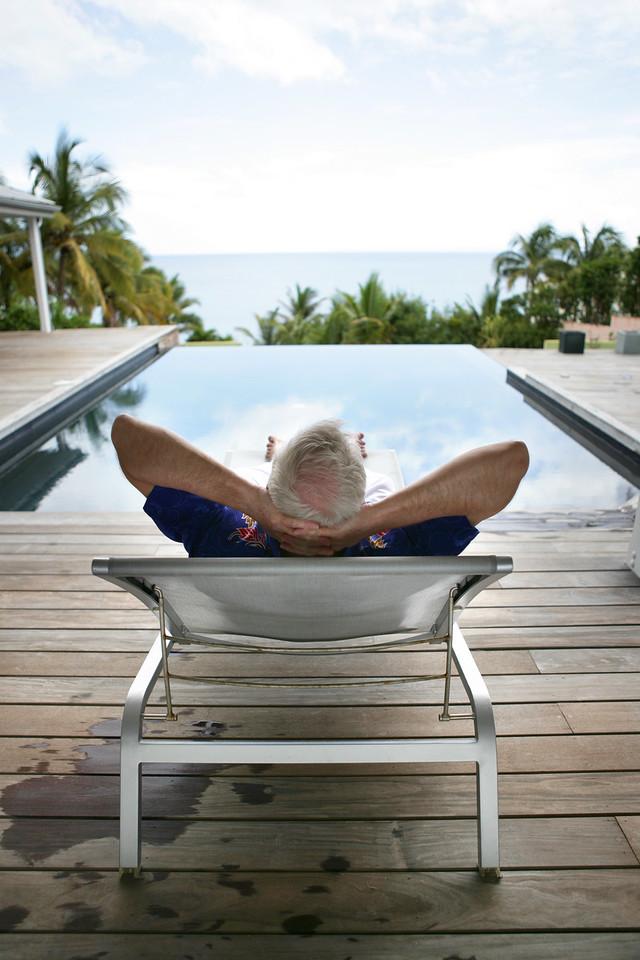 Senior man relaxing poolside