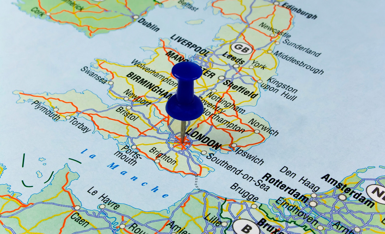 Blue pin pointing on london in europe map