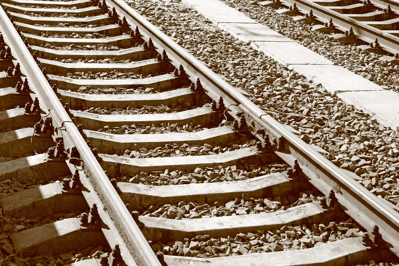 Straight railway in sepia