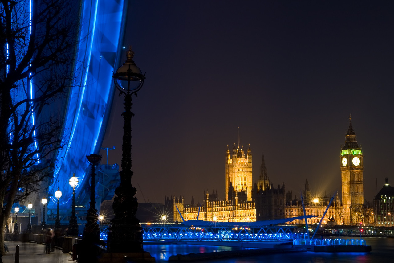 Night time shot of London showing Big Ben, The Houses of Parliament, The London Eye and the River Thames
