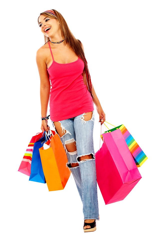 woman walking and smiling carrying shopping bags isolated over a white background