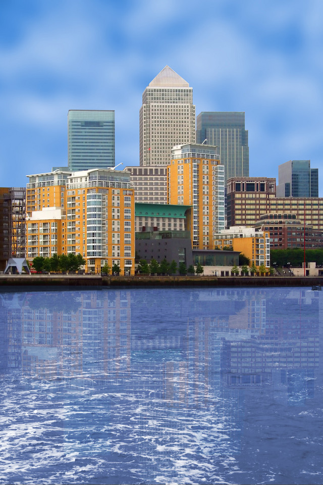 business village view with a river at the front - canary wharf in London, UK