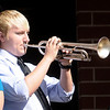 Anderson High School band students perform Taps.