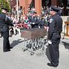 Officers fold a flag for Kilo.