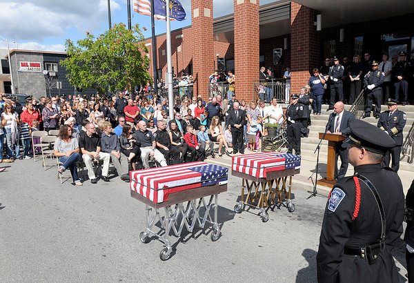 A last call memorial service in honor of Anderson K-9 officers Kilo and Magnum is held in front of the police department.