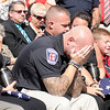 """Officer Marty Dulworth puts his head in his hands after calling dispatch to report his K-9 partner Kilo """"10-42 for the last time"""" during a last roll call memorial service in honor of Anderson K-9 officers Kilo and Magnum on Saturday."""