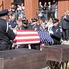 Officers fold a flag for Magnum.