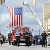 A memorial procession for APD K-9 officers Kilo and Magnum travels south on Main Street towards the police department for a last roll call service on Saturday.