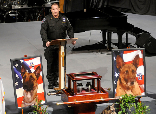 APD Lt. John Branson delivers the eulogy for K-9 officers Kilo and Magnum during a memorial service in their honor at East Side Church of God on Saturday.