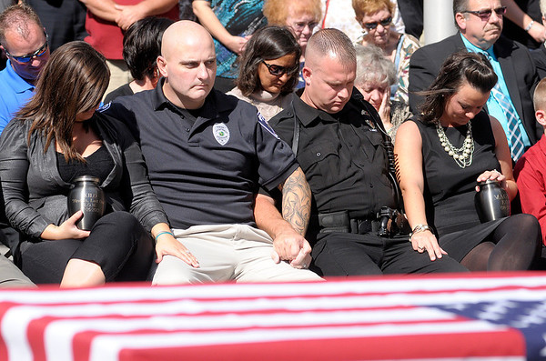 Officers Marty Dulworth and Matt Jarrett and their wives bow their heads during a prayer.