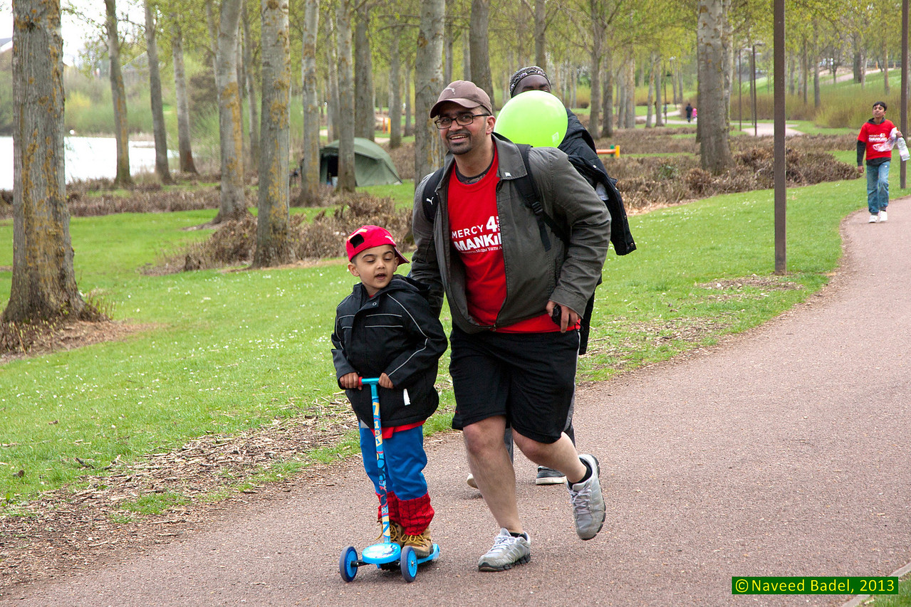 Father and son doing the walk... well one doing the other enjoying his ride!