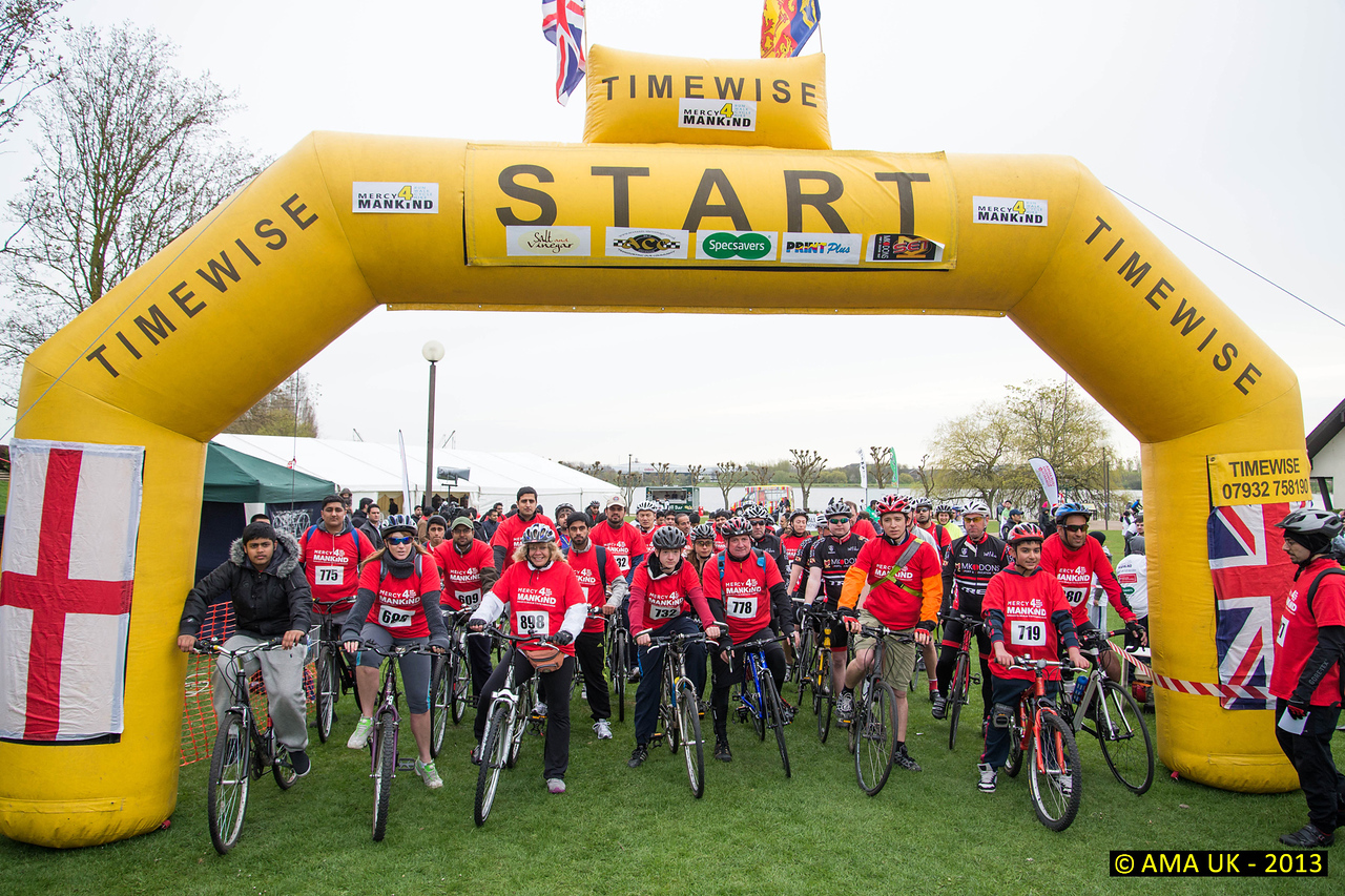 To encourage members to participate in the bikeathon, MKA also hired a number of bikes in case khuddam who wished to participate were not able to transport their own bikes to Milton Keynes. The Bikeathon started before the walk/run and photos shows cyclists eager to start.<br /> Photo Ref: CC tk-3473