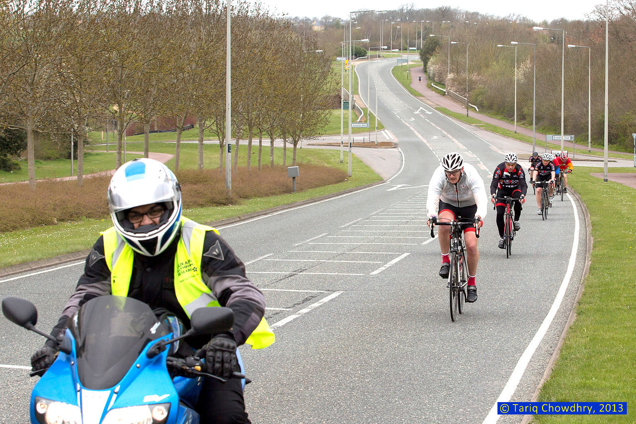 A motor bike escort for the cyclists!